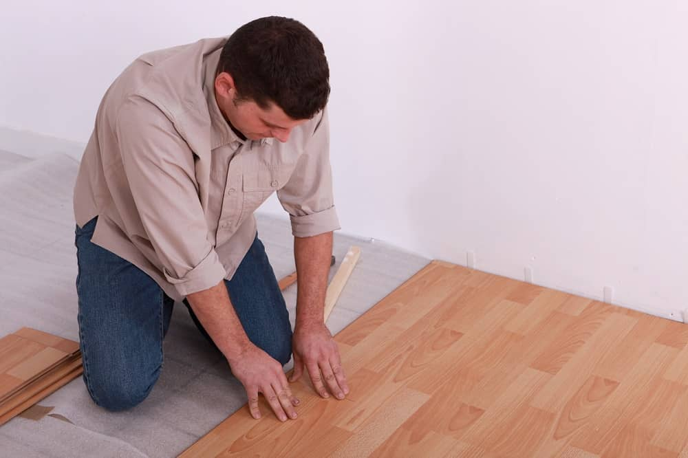 Man Laying Floors