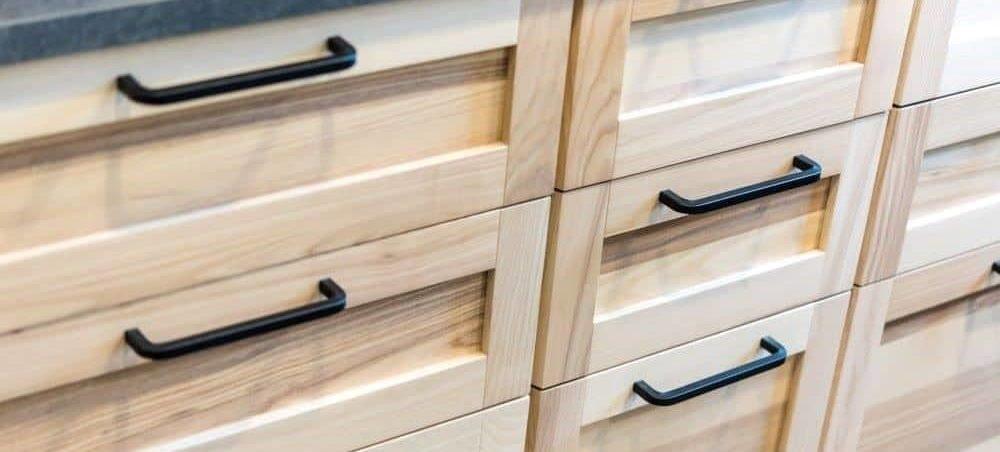 Upgrade your cabinet doors with leftover flooring scraps.
