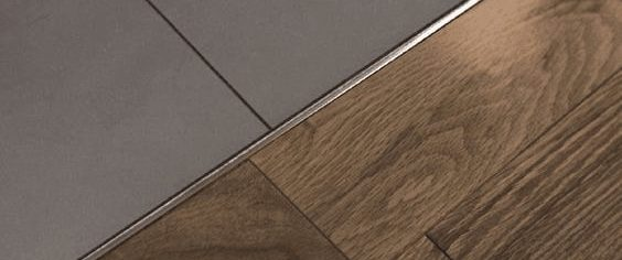 An example of a raft of timber flooring transitioning to tiles.