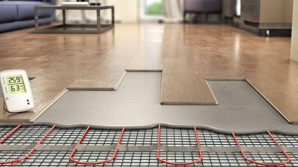 Underfloor heating system installed under laminate planks is a form of On Slab installation.